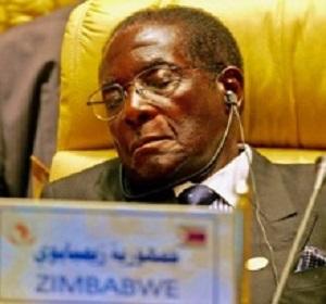 Zimbabwe's President Mugabe closes his eyes during Africa Union meeting in Sirte, Libya.