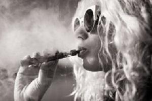Black and white picture of woman smoking e-cigarette